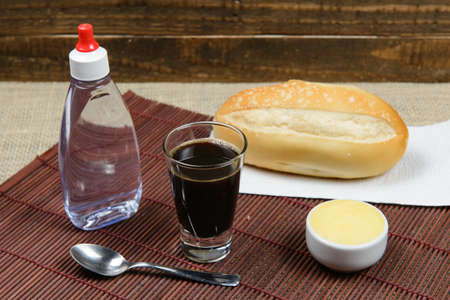 Basic Brazilian breakfast with coffee and bread with butter