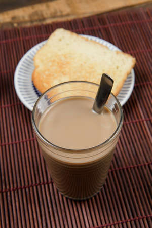 typical brazilian small breakfast, with cup of coffee with milk and bread Reklamní fotografie