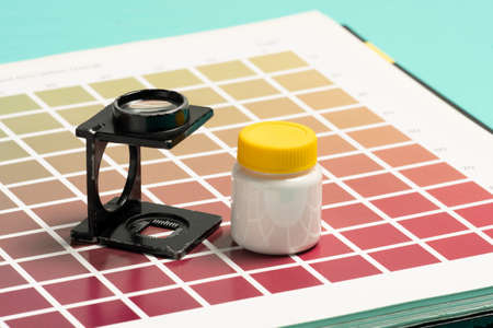 Wire-type magnifying glass on samples of color scale for printing and lithography