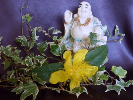 Laughing buddha with ivy and yellow rose of sharon flower stock laughing buddha with ivy and yellow rose of sharon flower stock photo picture and royalty free image image 3394026 mightylinksfo