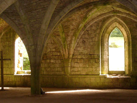 infirmary: Sunny arched window in medieval infirmary wing at Fountains Abbey, North Yorkshire Stock Photo