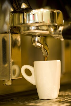 Close up of coffee machine and cup photo
