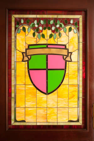 church interior: It worked with stained glass and a classic example of a door. Stock Photo