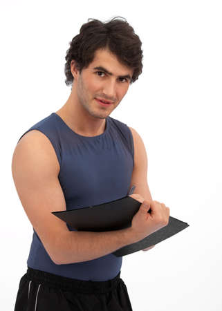 scribbling: Young, handsome personal trainer scribbling against white background Stock Photo