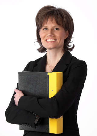 Happy and beautiful caucasian businesswoman hugging a yellow binder and looking at camera Stock Photo - 6815212