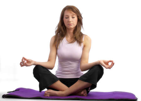 diffusion: Attractive, caucasian woman in a tranquill yoga position, closed eyes and some diffusion Stock Photo