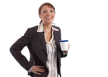 brak: Beautful, caucasian businesswoman on her coffee brak, smiling at camera