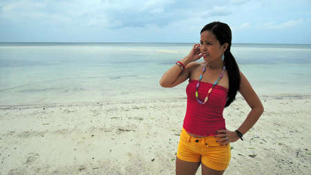 pinay: Filipina on a white sand beach in the morning