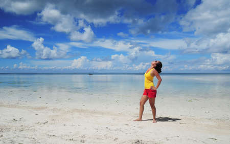 pinay: Filipina watching the sky on a white sand beach  early morning