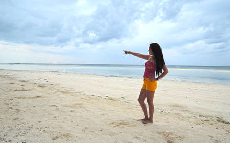 pinay: Filipina on a white sand beach