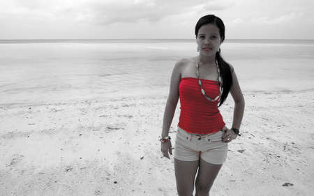 pinay: Filipina on a white sand beach  selective color