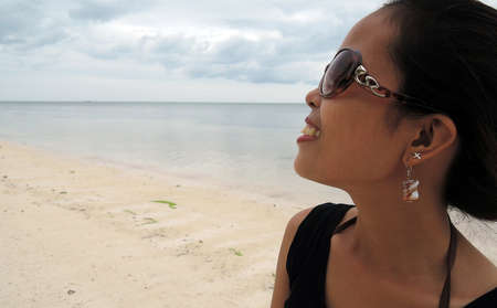 pinay: Filipina portrait on white sand beach Stock Photo