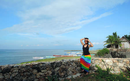 pinay: Filipina watching the ocean from a cliff resort Stock Photo