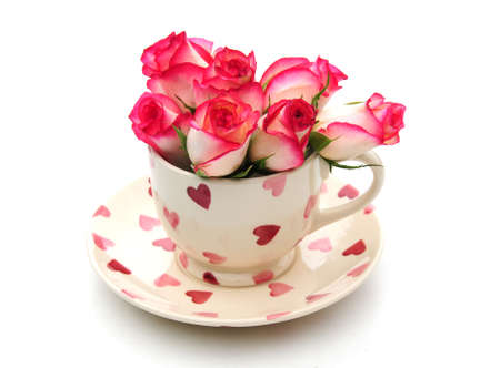 cup and saucer with roses Stock Photo
