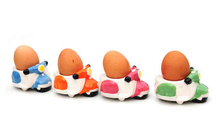 the novelty: eggs in novelty egg cups Stock Photo