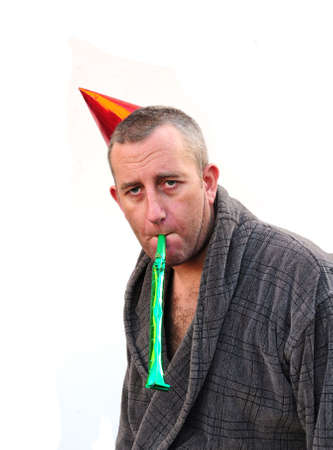 man in his dressing gown still partying Stock Photo