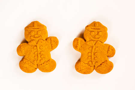 Two gingerbread man on white background. Concept of Christmas card