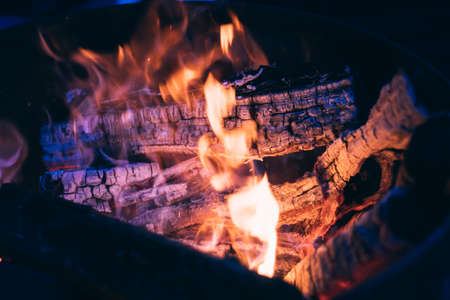 firewood background: hot Burning logs andglowing coal, firewood  background