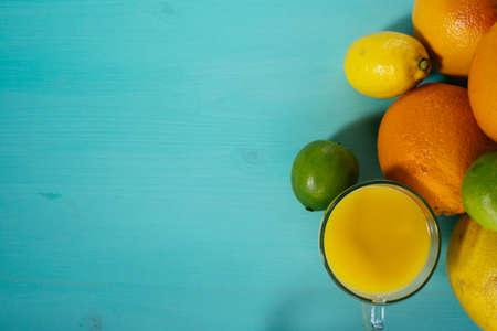 Fruit of citrus, orange, lime, lemon, pomelo, grapefruit with orange juice in a glass of glass