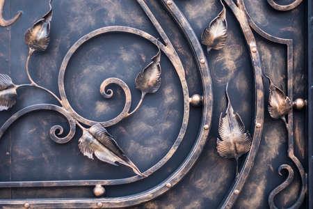 Forged flower decorative element gates Hammered gates. close-up