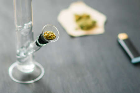 Bong and marijuana, cannabis thc flower Sativa and Indica Close up on a black background. Stock Photo