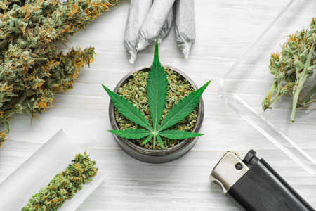 buds of marijuana, Leaf of cannabis, joint and a grinder with crushed weed on a white background close up Banque d'images