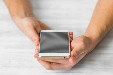 Man using white smartphone screen smart phone hands
