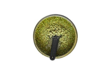 Kief in grinder for weed Trichomes buds of Cannabis macro top view isolated white background