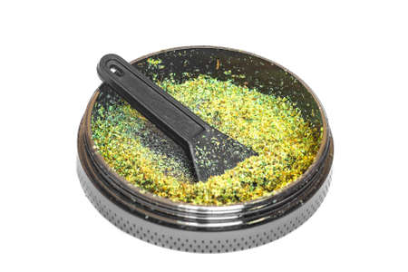 Kief in grinder Trichomes buds of Cannabis for weed macro