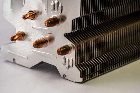 Aluminum radiator with copper heat pipe close-up with beautiful bokeh Metallic Standard-Bild