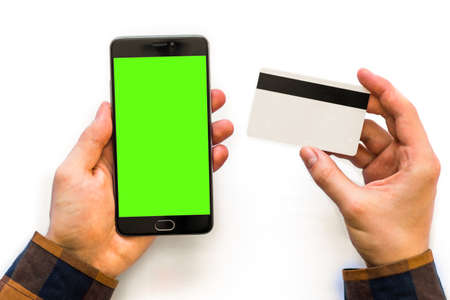 Online payments plastic card. green screen chroma key compositing Smartphone with Horizontal mockup. Фото со стока