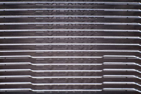 Aluminum radiator with copper heat pipe close-up with beautiful bokeh Metallic background