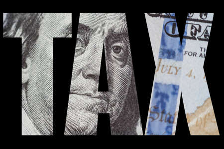 Macro close up of Ben Franklins face on the US 100 dollar bill.
