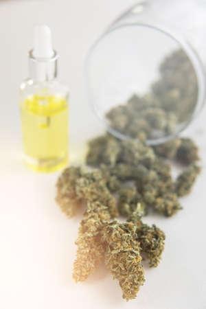 medical marijuana concept, CBD cannabis OIL, natural herb, close up, Cannabis oil in pipette, light leaks color tones vertical shot Standard-Bild - 125025123