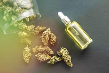 medical marijuana concept, close up, CBD cannabis OIL, Cannabis oil in pipette, light leaks color tones Stok Fotoğraf