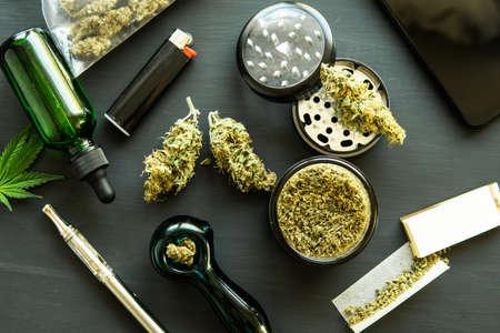 Macro Cannabis buds weed on black wood background.