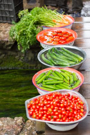 Vegetables soaked in basins