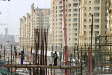 Construction site with worker in Dubai, United Arab Emirates. Dubai was the fastest developing city in the world.