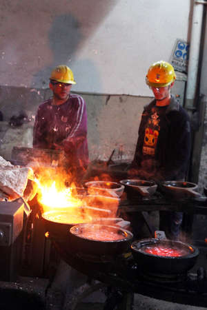 ISTANBUL, TURKEY - NOVEMBER 10: Turkish workers are working hard on November 10, 2013 in Istanbul, Turkey. Molten metal poured from ladle. Sajtókép