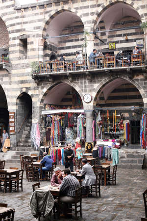 DIYARBAKIR, TURKEY - SEPTEMBER 28: Traditional shopping and resting building on September 28, 2009 in Diyarbakir, Turkey. Diyarbakir is one of the largest cities in southeastern Turkey.