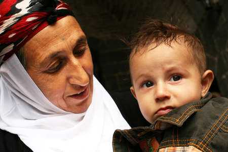 DIYARBAKIR, TURKEY - SEPTEMBER 28: Kurdish mother and son portrait on September 28, 2009 in Diyarbakir, Turkey.