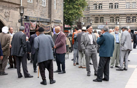 DIYARBAKIR, TURKEY - SEPTEMBER 28: Old Kurdish people talking at Diyarbakir City Center on September 28, 2009 in Diyarbakir, Turkey. Diyarbakir is one of the largest cities in southeastern Turkey.