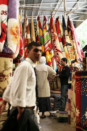 DIYARBAKIR, TURKEY - SEPTEMBER 28: People shopping at traditional bazaar on September 28, 2009 in Diyarbakir, Turkey. Diyarbakir is one of the largest cities in southeastern Turkey.