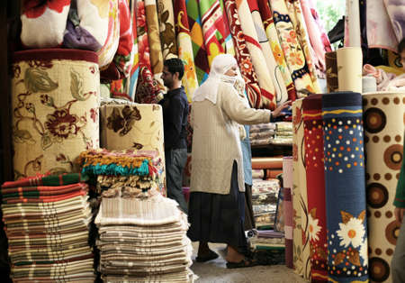 DIYARBAKIR, TURKEY - SEPTEMBER 28: Kurdish woman shopping at traditional bazaar on September 28, 2009 in Diyarbakir, Turkey. Diyarbakir is one of the largest cities in southeastern Turkey.