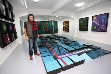 ISTANBUL, TURKEY - NOVEMBER 11: Turkish-Kurdish painter and visual artist Ahmet Gunestekin on November 11, 2010 in Istanbul, Turkey. He works span painting, conceptual art and constructions sculpture.