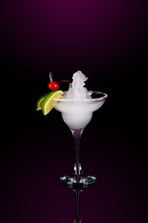 Smoothies in chilled salt rimmed glass with tequila crushed ice in cocktails glass on black background photo