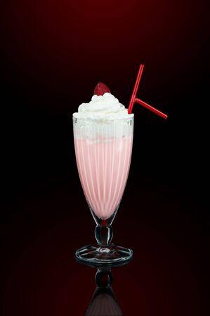 Milk shake with cream, cherry and straw photo