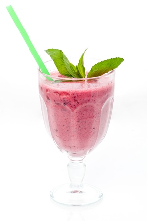 Pink smoothies with mint and straw isolated on white background photo