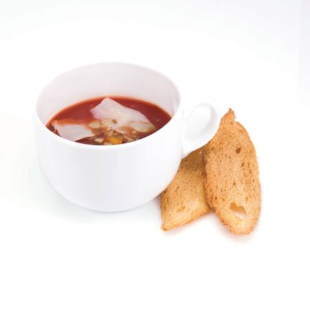 Gazpacho with croutons on white background photo