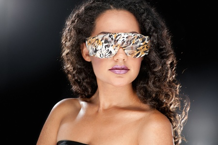Party girl in club glasses photo